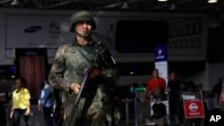 FILE - A police officer patrols inside Rio de Janeiro International Airport in Rio de Janeiro, Brazil, July 27, 2016.