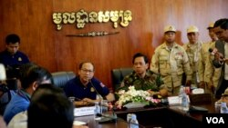 Phay Siphan, a gov't spokesperson along with Chhum Socheat, a spokesperson of the ministry of defense during a rare media tour at Ream Naval Base in Preah Sihanouk province, Cambodia, Friday, July 26, 2019. (Sophat Sophat/VOA Khmer)
