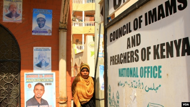 Campaign posters are seen on exterior walls of the office of the Council of Imams and Preachers of Kenya in Mombasa February 21, 2013 (J. Craig/VOA).