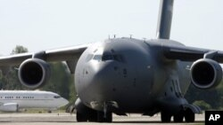 A Boeing C-17 transport aircraft, known as the Globemaster, shown here at the Papa Air Base in Papa, Hungary, July 27, 2009.