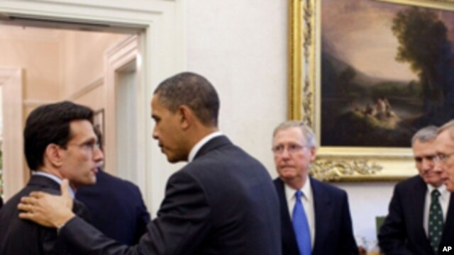 President Barack Obama talks with Rep. Eric Cantor, R-Va., at the conclusion of a meeting with bipartisan Congressional leadership in the Oval Office Private Dining Room, Nov. 30, 2010. Listening at right are: Sen. Mitch McConnell, R-Ky.; Sen. Jon Kyl, R-