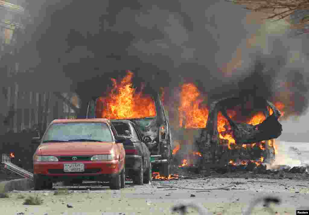 Vehicles are seen on fire after a blast in Jalalabad, Afghanistan.