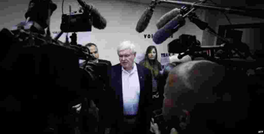 Republican presidential candidate, former House Speaker Newt Gingrich talks with the media during a stop at his campaign office, Thursday, Dec. 29, 2011, in Sioux City, Iowa. (AP Photo/Eric Gay)