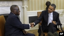 Ghana's President John Evans Atta Mills (left) with President Obama at the White House, Mar 8, 2012