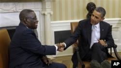 Ghana's President John Evans Atta Mills (left) with President Obama at the White House, Mar 8, 2012
