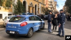Italian police stand by an evacuated school after four earthquakes hit central Italy in the space of an hour, shaking the same region that suffered a series of deadly quakes last year, in Rome, Jan. 18, 2017.