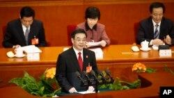 中国最高法院院长周强在人大会议上作报告(2014年3月10日)
