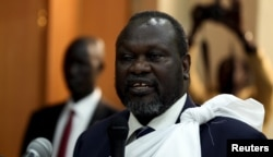 FILE - South Sudan's opposition leader Riek Machar speaks during a briefing.