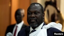 FILE - South Sudan's opposition leader Riek Machar speaks during a briefing ahead of his return to South Sudan as vice president, in Ethiopia's capital Addis Ababa, April 9, 2016.