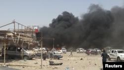 6月9日伊拉克炸弹爆炸现场浓烟滚滚