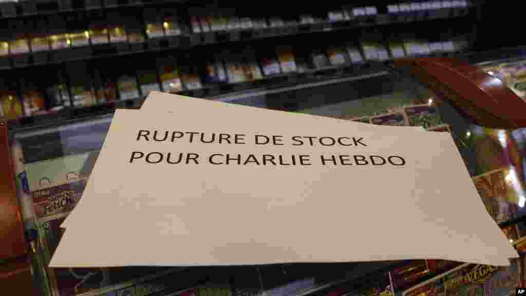 "A banner reading: ""Stock shortage for Charlie Hebdo"" is placed at a newsstand in Lille, northern France, Jan. 14, 2015."