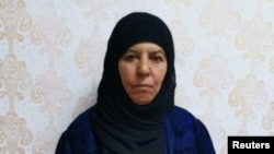 Rasmiya Awad, believed to be the sister of slain Islamic State leader Abu Bakr al-Baghdadi, who was captured on Monday in the northern Syrian town of Azaz by Turkish security officials, is seen in an unknown location in an undated picture provided by Turkish security officials.