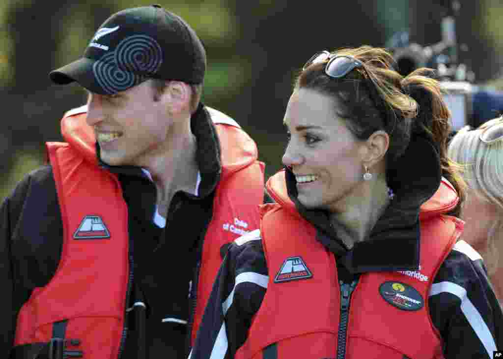 Britain's Prince William and his wife Kate, the Duchess of Cambridge, smile after taking a ride on a jet boat along the Shotover River in Queenstown, New Zealand.