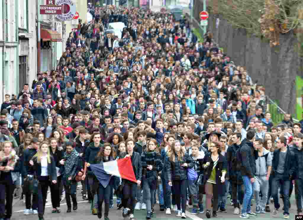 High school students march past during a demonstration  on the streets in Le Mans, north-western France, to pay tribute to victims of the attacks claimed by Islamic State which killed at least 129 people and left more than 350 injured on Nov. 13.