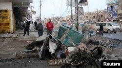 Hiện trường sau một vụ nổ bom tại thủ đô Baghdad, ngày 14/1/2014.