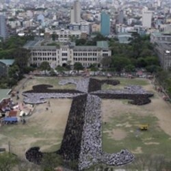 More than 20,000 people in Manila attempt to break the Guinness record for largest human cross earlier this year