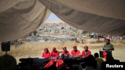 Julius Malema, leader of South Africa's Economic Freedom Fighters (EFF), gestures during a media briefing in Alexander township near Sandton, South Africa, Aug. 17, 2016.