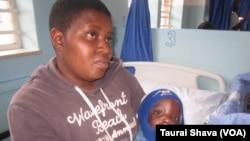 Silethubuhle Mkandla and her child Andiswa Nyoni, beneficiary of the Operation of Hope program.