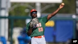 Cirr-Nicholas Bohannon plays on the Florida A&M baseball team. The school is one of about 100 HBCUs in the U.S. (AP Photo/Gary McCullough)