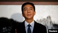 北京的中央人民政府駐香港特別行政區聯絡辦公室主任駱惠寧。