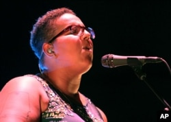 FILE - Brittany Howard with Alabama Shakes performs at Verizon Wireless Amphitheatre at Encore Park in Atlanta, Georgia, Aug. 21, 2015.