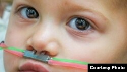 This 2-year-old child wears a pediatric nasal cannula, which delivers odors. (Credit: Ofer Perl)