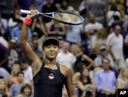 Naomi Osaka, of Japan, celebrates after defeating Madison Keys during the semifinals of the U.S. Open tennis tournament, Thursday, Sept. 6, 2018, in New York. (AP Photo/Seth Wenig)