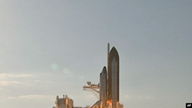 Space shuttle Discovery lifts off, February 24, 2011