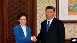 2019年12月16日, 中国国家主席习近平接见来北京述职的香港特区行政长官林郑月娥.