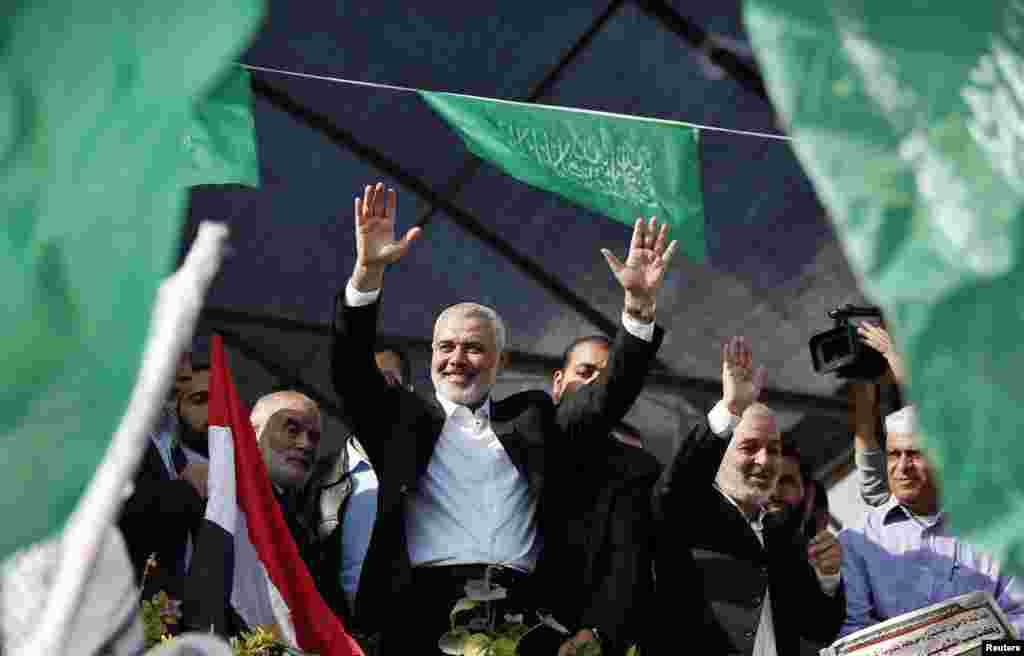 Senior Hamas leader Ismail Haniyeh waves to people as they celebrate what they say is a victory over Israel after an eight-day conflict, Gaza City, November 22, 2012.
