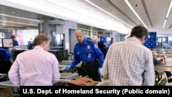 "At security checkpoints, travelers place their belongings into plastic containers usually called ""bins."""