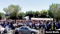 In this image shared on social media, hundreds of Iranians march in the central city of Isfahan's New Shapur district, July 31, 2018, to denounce the government's handling of the rial's recent slump to record lows against the dollar.