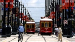 Two streetcars pass each other on Canal Street in New Orleans, Louisiana.