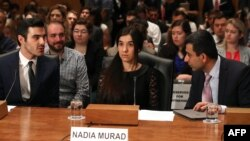 Nadia Murad, (C), human rights activist, testifies during Senate Homeland Security and Governmental Affairs Committee hearing on Capitol Hill in Washington, June 21, 2016.