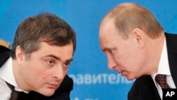 FILE - Russian President Vladimir Putin and former deputy chief of staff Vladislav Surkov, Feb. 13, 2012.