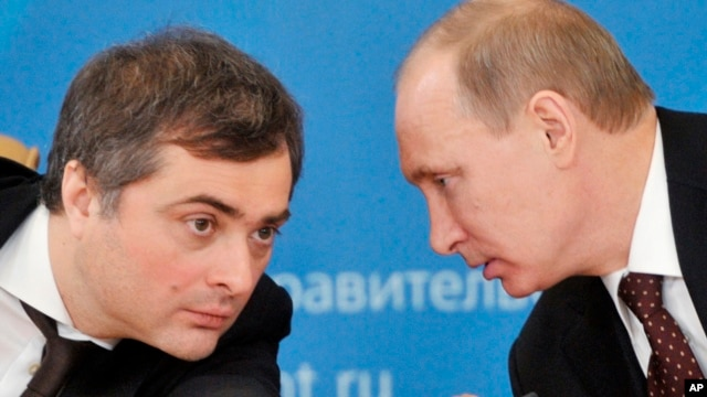 Russian President Vladimir Putin (r) speaks with former deputy chief of staff Vladislav Surkov, (File photo).
