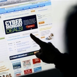 A woman from California points to a Cyber Monday advertisement on her computer. The Monday after Thanksgiving is a big day for Internet shopping. Sales online have only grown since the day got its name in 2005