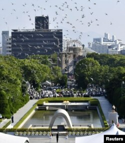 Doves fly over the Peace Memorial Park with the Atomic Bomb Dome in the background, at a ceremony in Hiroshima, western Japan, August 6, 2018, on the 73rd anniversary of the atomic bombing of the city. Mandatory credit Kyodo/via REUTERS