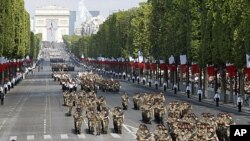 French army soldiers open the traditional Bastille Day parade on the Champs Elysees in Paris, July 14, 2011
