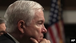 "U.S. Secretary of Defense Robert Gates listens to remarks at a Senate Armed Services Committee hearing on the ""Defense Authorization Request for FY2012"" on Capitol Hill in Washington, February 17, 2011. REUTERS/Jim Young (UNITED STATES - Tags: POLITICS"