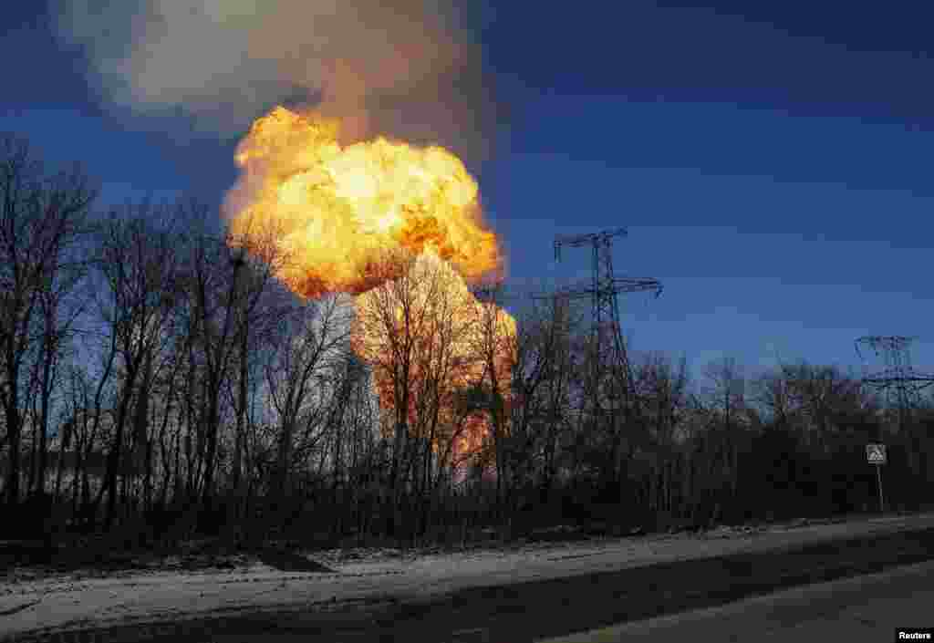 A view of an explosion after shelling is seen not far from Debaltseve, Ukraine. Government forces and pro-Russian separatists said they would not carry out an agreement to pull back heavy guns in east Ukraine.