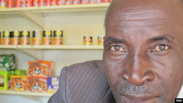 John Stheole has owned his spaza shop for more than a ten years in Dube Village, Soweto, South Africa. (Photo Gillian Parker for VOA)