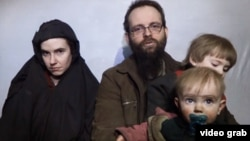 In this still image taken from a December 2016 video released by the Afghan Taliban, U.S. national Caitlan Coleman and her Canadian husband, Joshua Boyle read a statement urging then-President-elect Donald Trump to negotiate to secure their release.