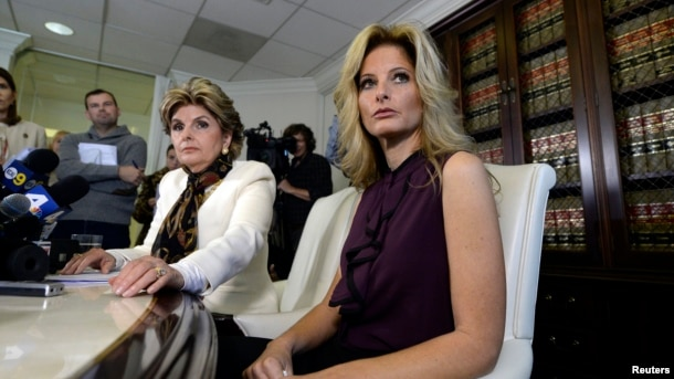 "Summer Zervos, a former contestant on the TV show ""The Apprentice,"" reacts next to lawyer Gloria Allred, left, while speaking about allegations of sexual misconduct against Donald Trump during a news conference in Los Angeles, Oct. 14, 2016."