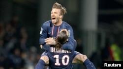 David Beckham and Zlatan Ibrahimovic celebrate. Paris Saint-Germain's was Beckham's last team.