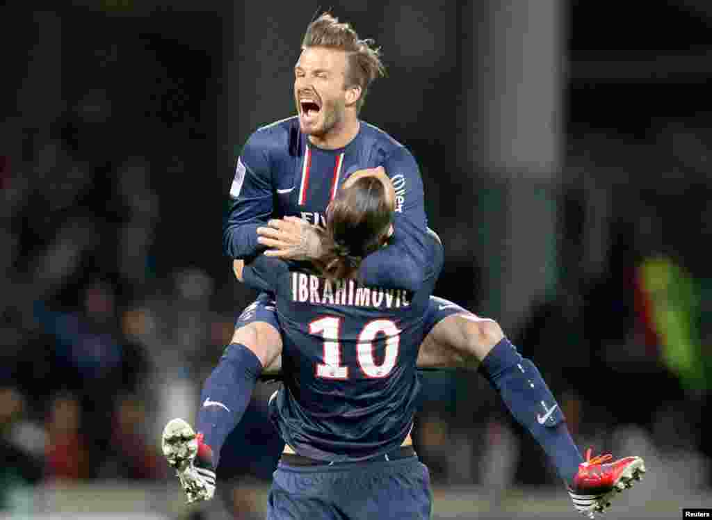 Paris Saint-Germain's Zlatan Ibrahimovic and David Beckham celebrate at the end of their team's French Ligue 1 soccer match against Olympique Lyon, May 12, 2013.