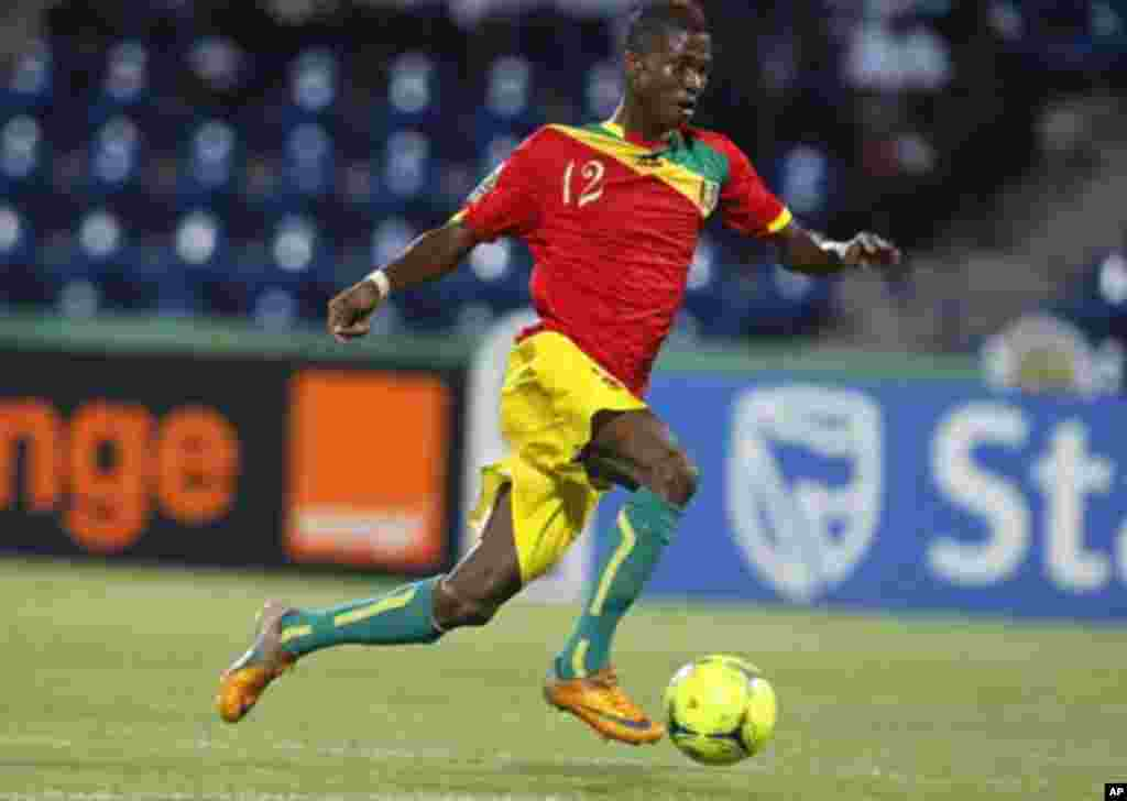 Guinea's Ibrahima Conte runs with the ball during their African Nations Cup Group D soccer match against Botswana at Franceville Stadium January 28, 2012.