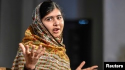 FILE - Malala Yousafzai of Pakistan speaks at the World's Children's Prize ceremony in Mariefred, Sweden, Oct. 29, 2014.