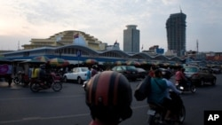Phnom Penh's skyline is fast seeing new skyscrapers, prompting artists to create works commenting on the rapid urbanization in the city. – Yong YN