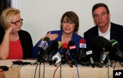 From left, U.S. Sens. Claire McCaskill of Missouri, Amy Klobuchar of Minnesota and Mark Warner of Virginia speak to reporters during a visit to Cuba in support of a bill aimed at lifting the U.S. trade embargo on the island nation, Feb. 17, 2015.